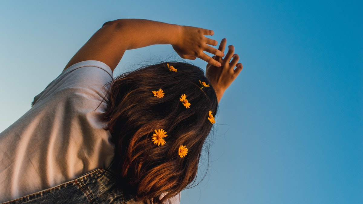low-angle-photo-of-girl-with-flowers-on-her-hair-2119568